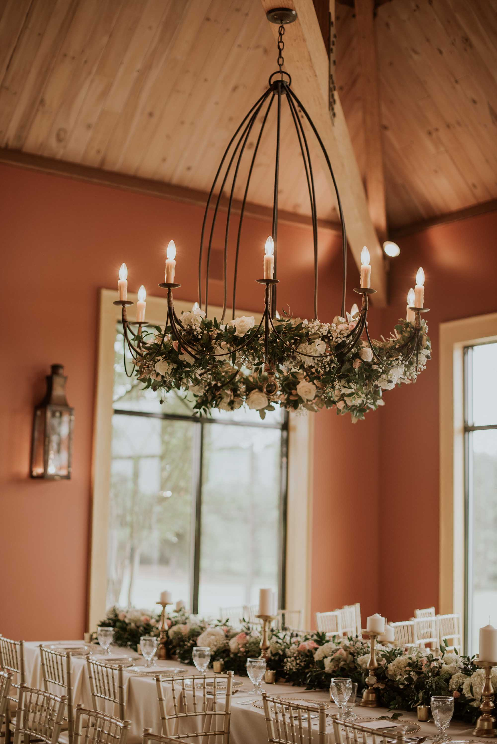 Premier wedding mississippi magazine vol 30 staff favorite this hanging floral installation demands that you stop and stare for a moment the chandelier lifts your eyes and allows you to take in the vaulted ceilings arubaitofo Choice Image