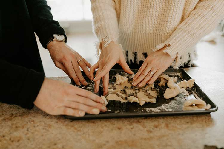 Couple Cooking Together | 10 Quarantine Date Ideas for Engaged Couples & Newlyweds | featured on I Do Yall | photo by Hannah Busing