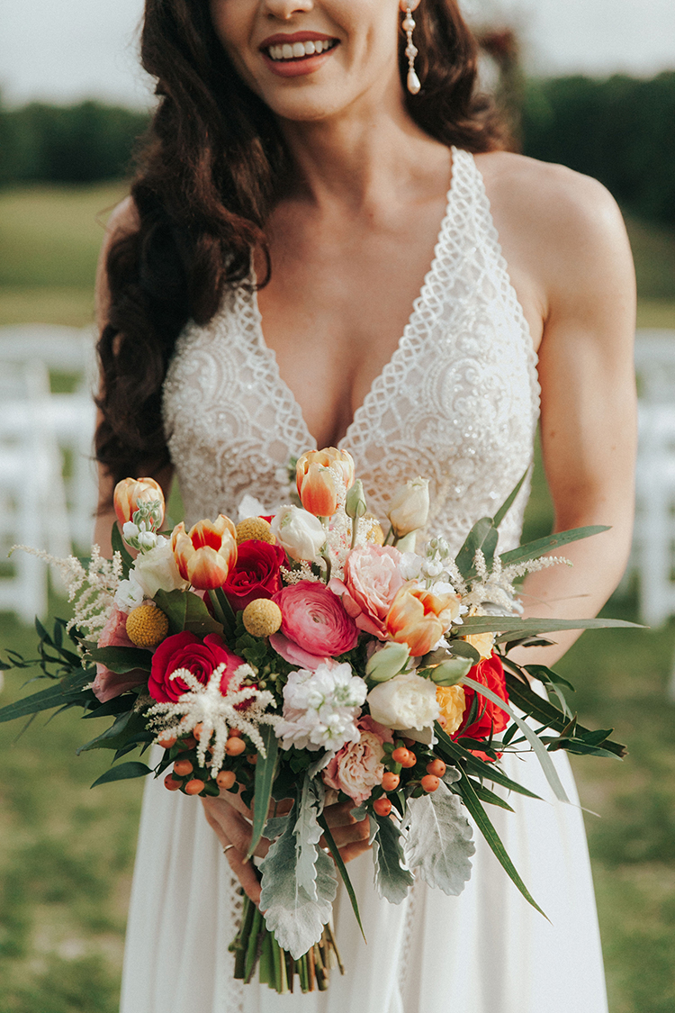 Colorful Wedding Bouquet with Tulips, Ranunculus, and Roses | photo by Deltalow | featured on I Do Y'all