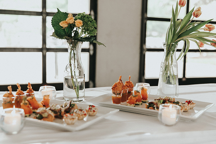 Wedding Food with Clear Vases & Florals | photo by Deltalow | featured on I Do Y'all