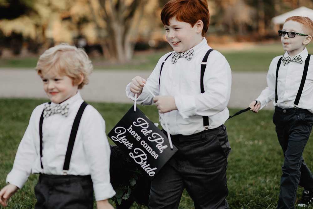Ring Bearers in Suspenders & Bowties | photo by Emily Green Photography | featured on I Do Y'all