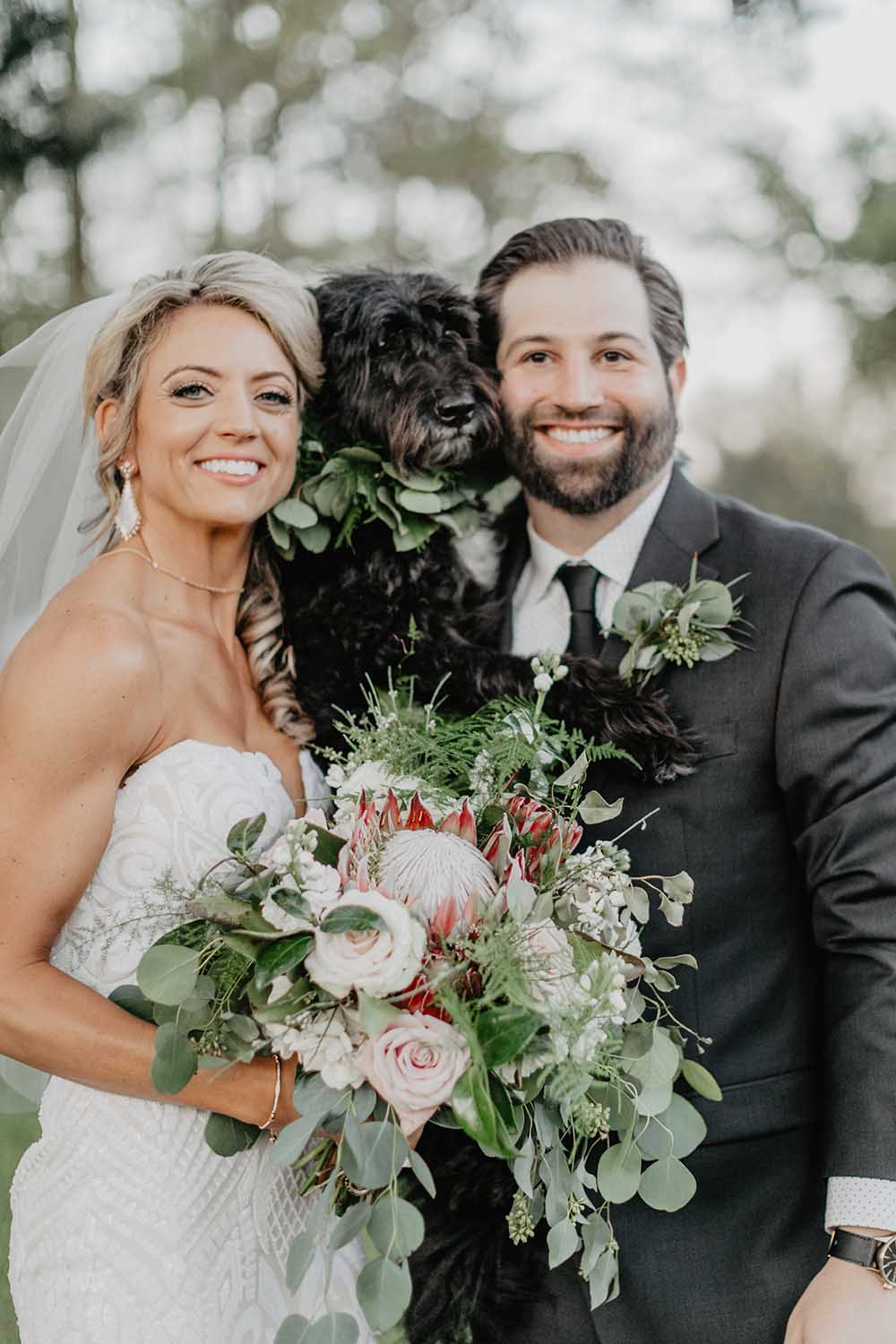 Bride & Groom with Dog with Greenery Collar | photo by Emily Green Photography | featured on I Do Y'all