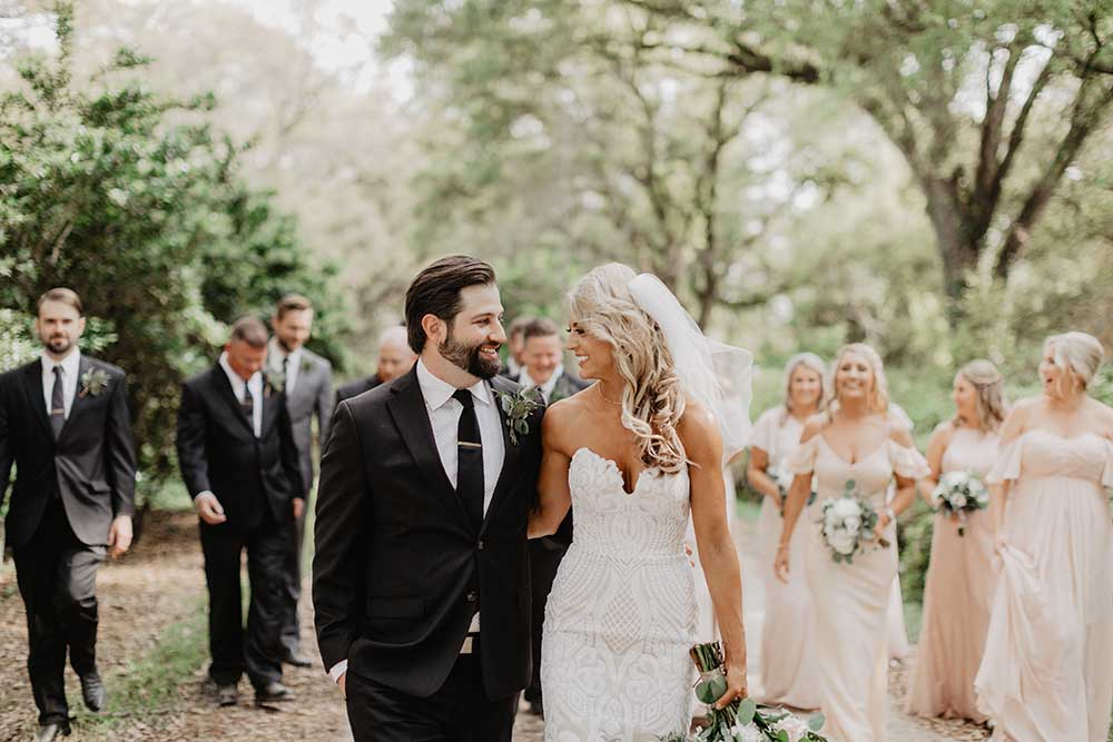 Wedding Portraits with Wedding Party Behind | photo by Emily Green Photography | featured on I Do Y'all