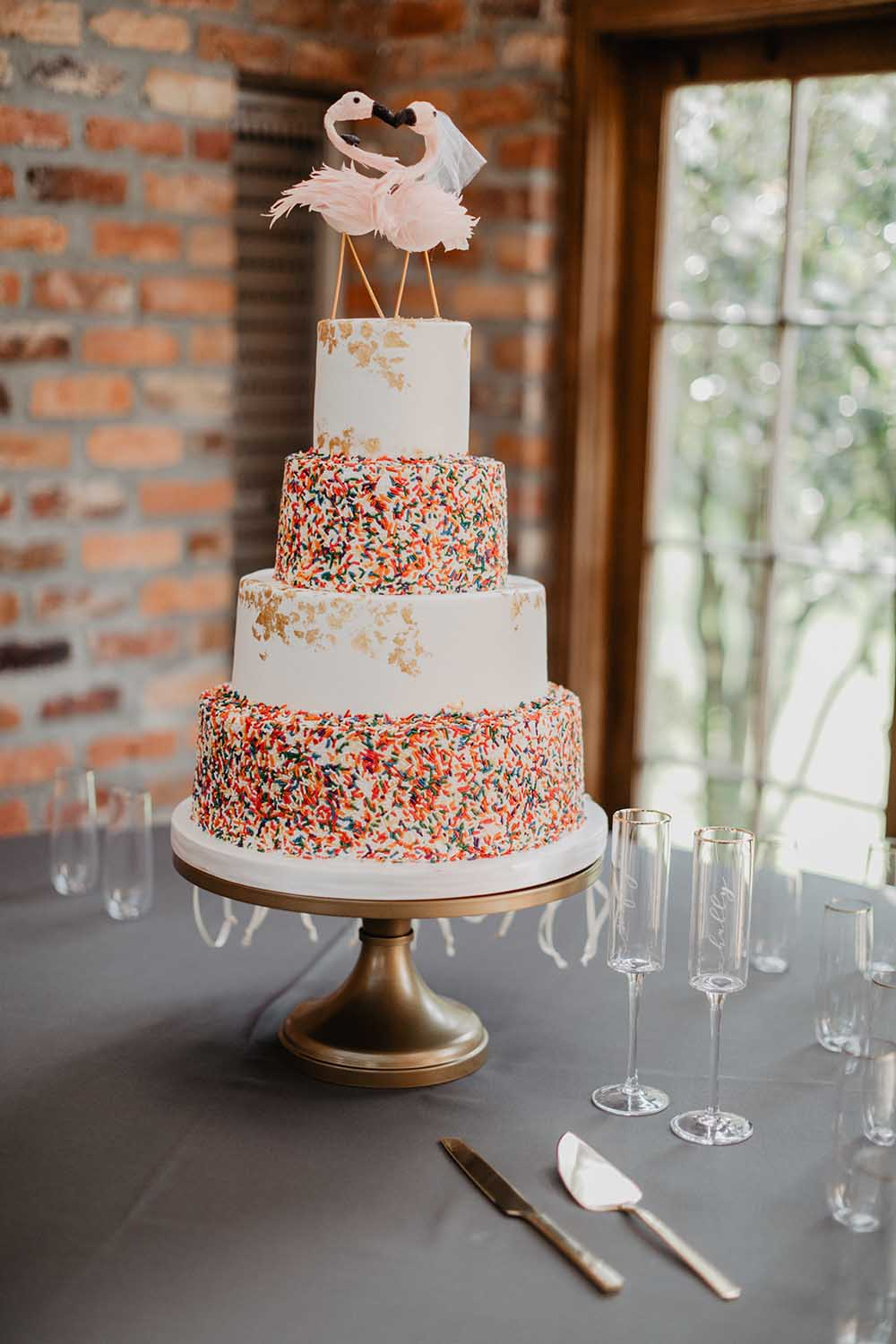 Confetti Sprinkle Wedding Cake with Flamingo Cake Toppers | photo by Emily Green Photography | featured on I Do Y'all