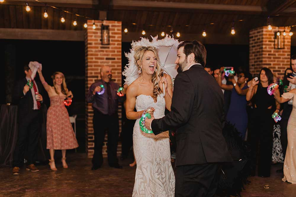 Bride with Second Line Umbrella & Tambourine | photo by Emily Green Photography | featured on I Do Y'all