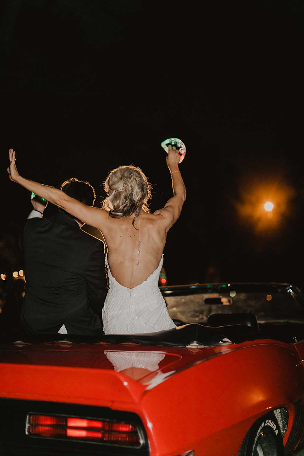 Bride & Groom Leaving in Red Convertible | photo by Emily Green Photography | featured on I Do Y'all