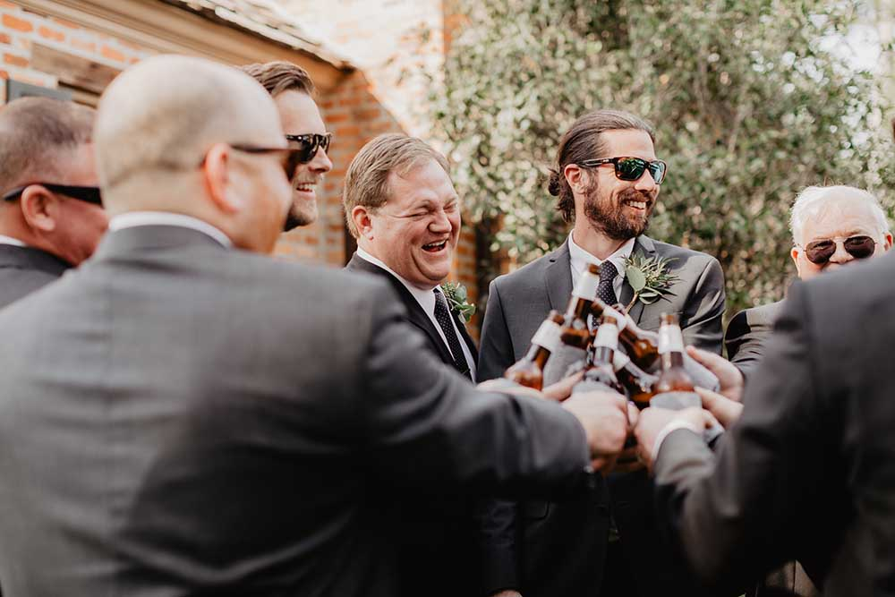 Groomsmen Cheersing Beers at Fun Louisiana Wedding | photo by Emily Green Photography | featured on I Do Y'all