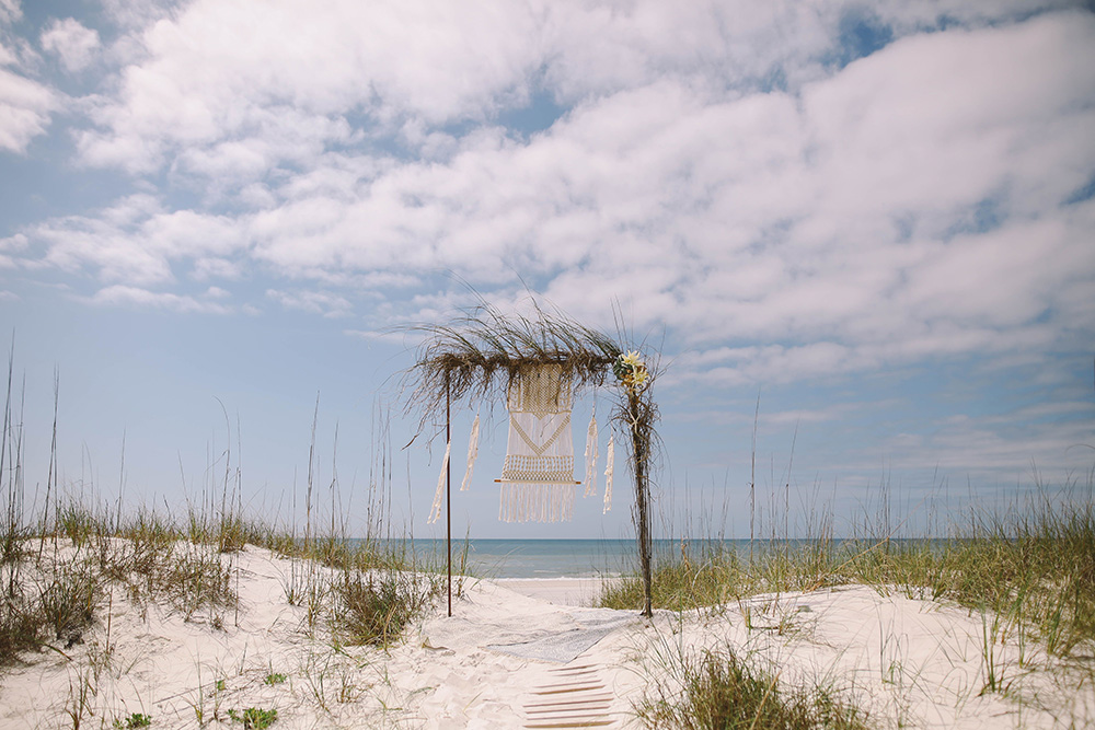 Boho Beach Wedding Ceremony Decor with Macrame | featured on I Do Y'all