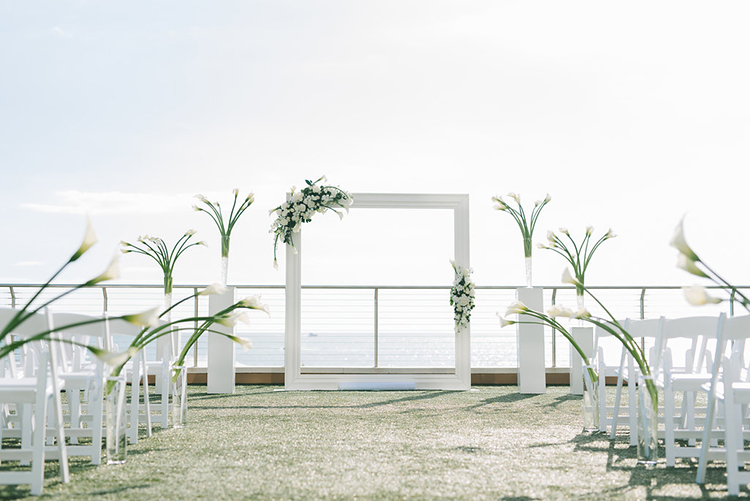 Modern Oceanside All-White Wedding Ceremony Decor | photo by Kera Photography | featured on I Do Y'all