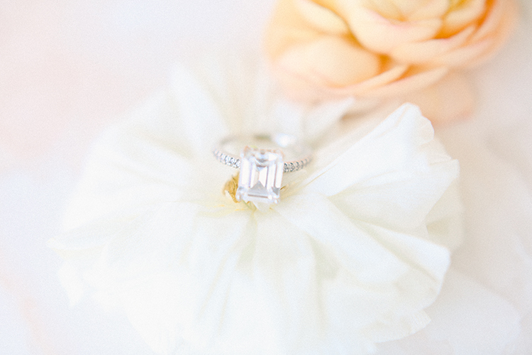 Rose Gold Emerald Cut Engagement Ring on Peach & Cream Flowers | photo by Pendo Photography | featured on I Do Y'all