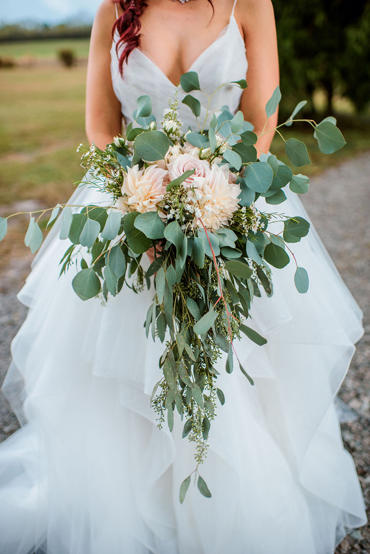 Lush wedding bouquet with dahlias, roses, and eucalyptus leaves | photo by John Myers Photography | featured on I Do Y'all