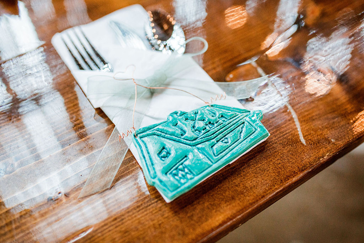 Handmade colorful barn Christmas ornament for wedding guest favor | photo by John Myers Photography | featured on I Do Y'all