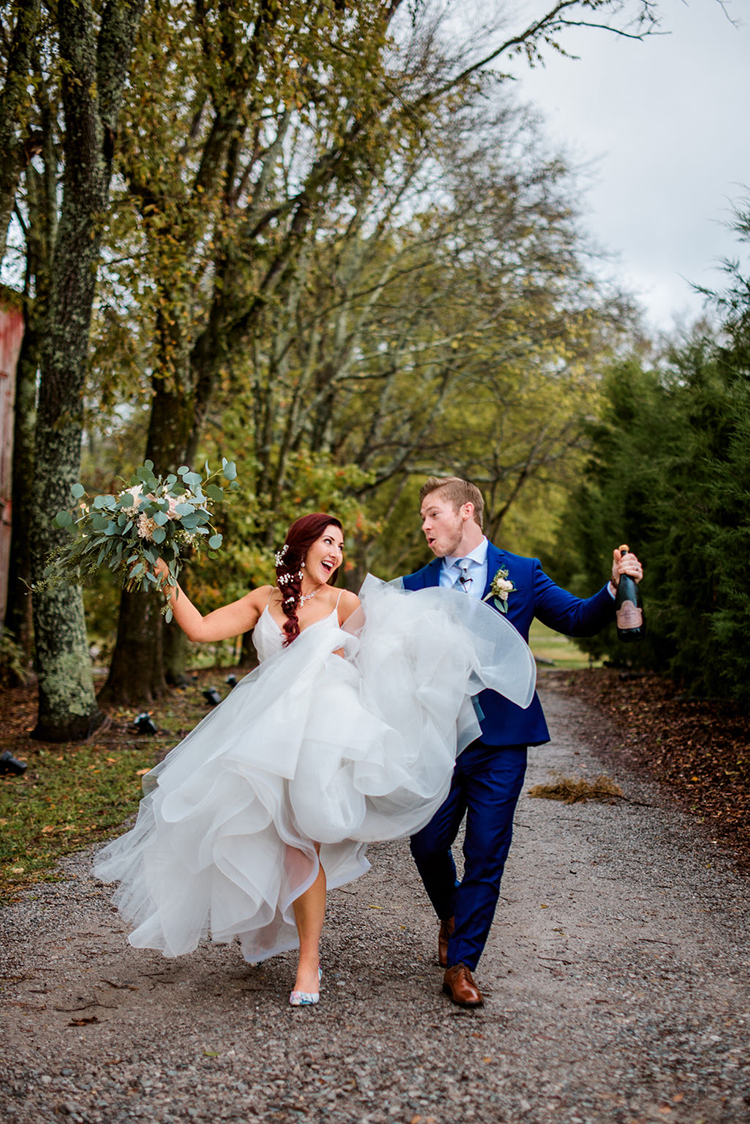 Bride & Groom Skipping After Wedding | photo by John Myers Photography | featured on I Do Y'all