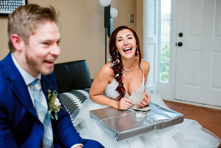 Bride laughing while opening gifts | photo by John Myers Photography | featured on I Do Y'all