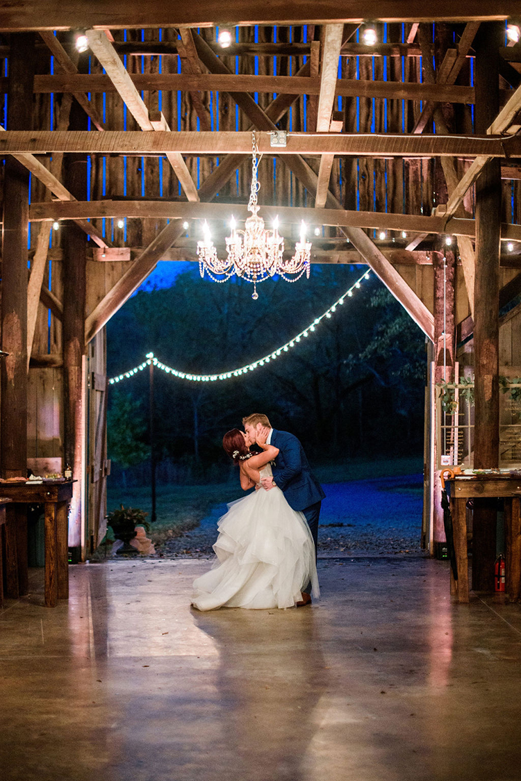 Bride & Groom Kiss during First Dance at Joyful & Bright Barn Wedding | photo by John Myers Photography | featured on I Do Y'all
