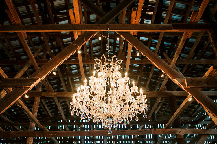 Chandelier in wedding barn | photo by John Myers Photography | featured on I Do Y'all