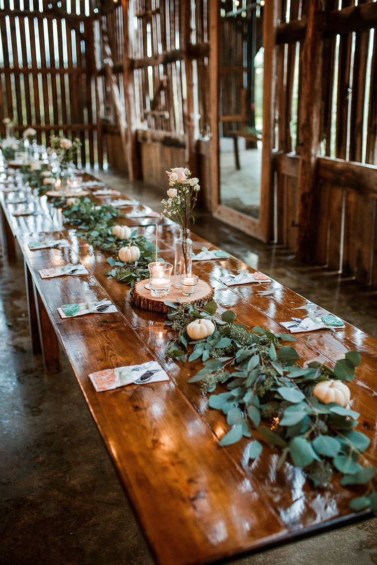 Long barn banquet tables with rustic fall wedding decor | photo by John Myers Photography | featured on I Do Y'all