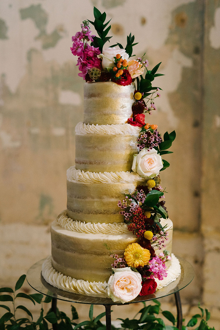 4-Tiered Gold Painted Wedding Cake with Lush Floral Pieces | photo by Staci Lewis Photography | featured on I Do Y'all