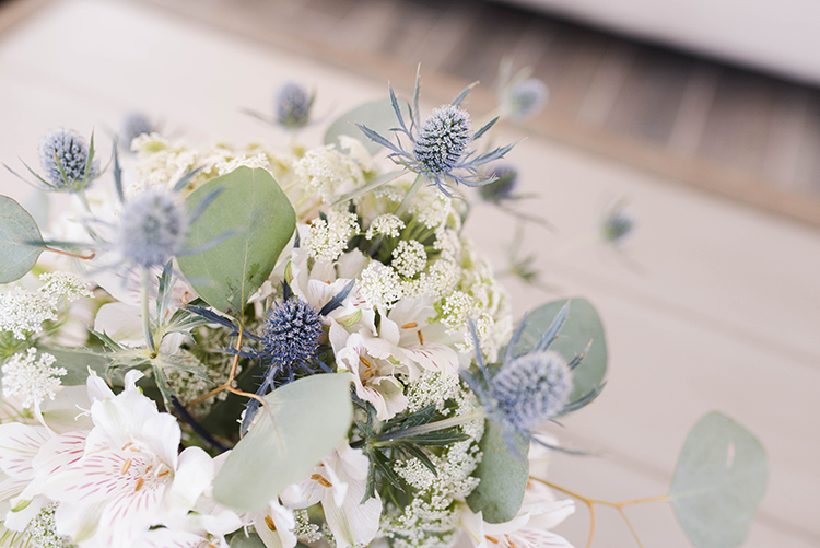 Beachy wedding bouquet with sea holly thistles and orchids | photo by Southern Wedding Pixels | featured on I Do Y'all