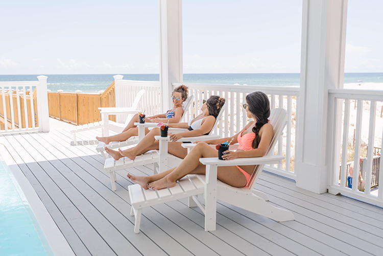 Bride & Bridesmaids Relaxing by Pool at Gulf Front Beach House | photo by Southern Wedding Pixels | featured on I Do Y'all