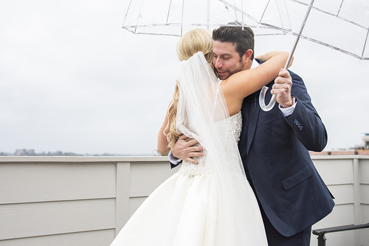 First Look with Bride & Groom Under Umbrellas | photo by Jessica Merithew Photography | featured on I Do Y'all