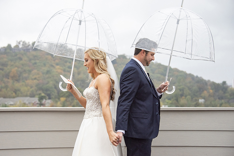 Bride & Groom Reading Letters to Each Other Under Umbrellas | photo by Jessica Merithew Photography | featured on I Do Y'all