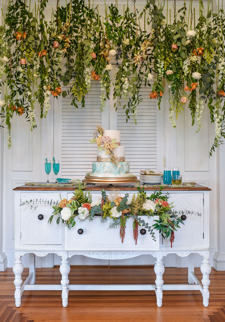 Wedding Cake Display with Hanging Florals & Greenery | Vintage Shabby Chic Wedding Cake Display | photo by Radiant Photography by Sydney Danielle