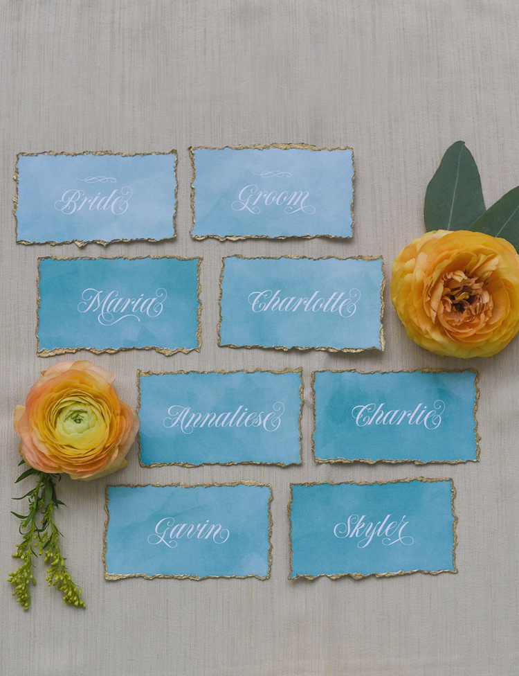 Turquoise Watercolor Wedding Place Cards with Gold Foil Rim & Calligraphy Names | photo by Radiant Photography by Sydney Danielle