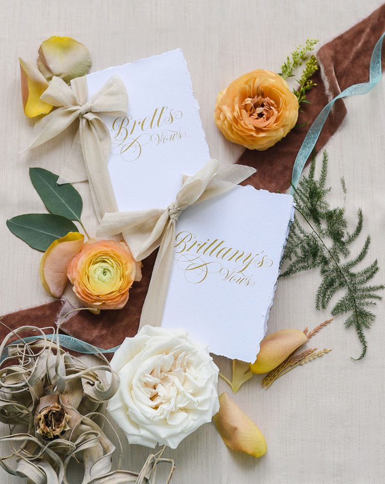 Elegant Vowbooks with Calligraphy Cover and Ribbon | photo by Radiant Photography by Sydney Danielle