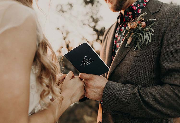 Groom Reading His Vows from Vow Book | Words of Affirmation Love Language | photo by Nikk Nguyen Photo | featured on I Do Y'all