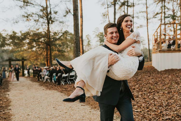 Groom Carrying Bride Down Aisle for Fall Wedding | photo by Jen Menard Photography | featured on I Do Y'all