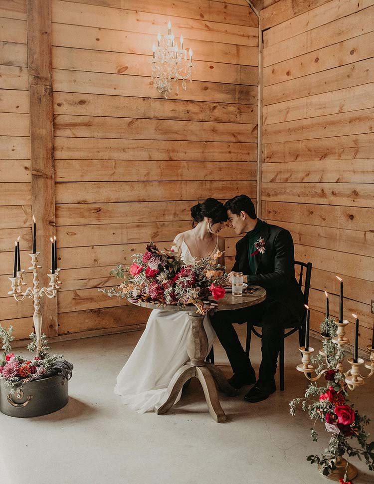 Bride & Groom at Moody Sweetheart Table with Candles | Quality Time Love Language | photo by Nikk Nguyen Photo | featured on I Do Y'all