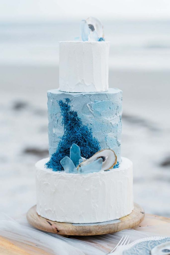 Blue Watercolor Wedding Cake with Oyster Shells | photo by Amanda Zabrocki Photography