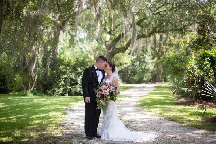 Bride & Groom Under Live Oak Tress at Swift-Coles Historic Home wedding | featured on I Do Y'all