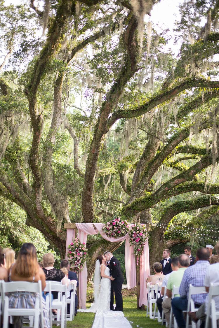 Outdoor Wedding with Live Oak Trees & Spanish Moss at Swift-Coles Historic Home | featured on I Do Y'all