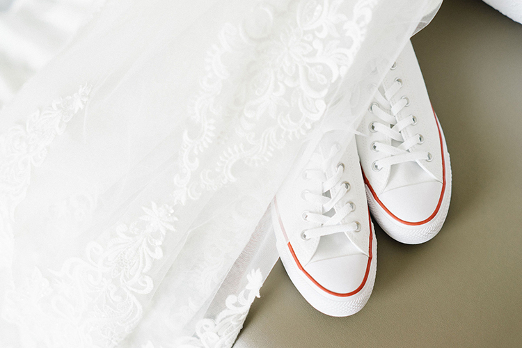 White Wedding Converse with Bridal Veil | Wedding Shoes That Aren't 6 Inch Heels | photo by Staci Lewis Photography