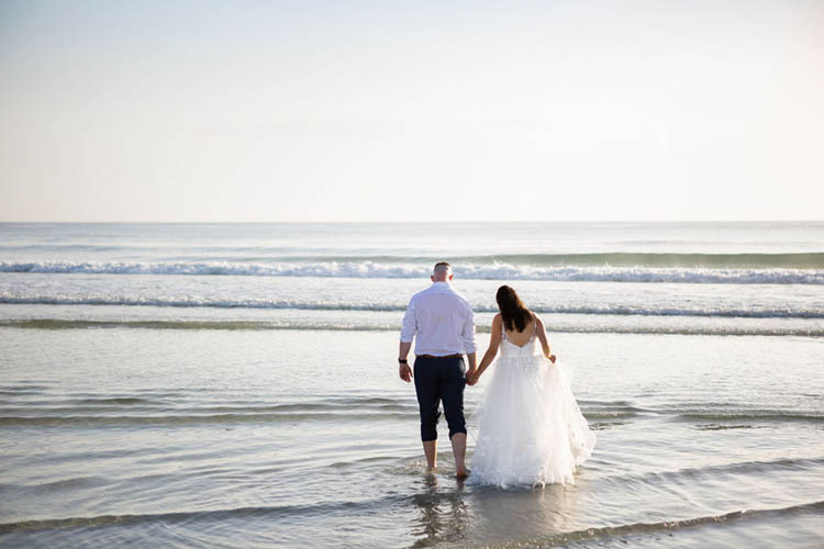 Bride & Groom in Ocean at Sunrise Beach Elopement | photo by  Dreamscape Photography, LLC