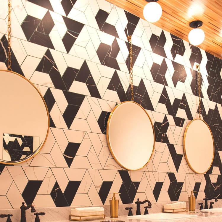 Modern Luxe Bathrooms with Round Gold Mirrors at Hotel Indigo Hattiesburg