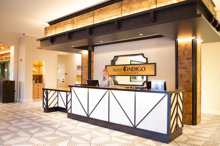 The modern industrial luxe lobby of Hotel Indigo Hattiesburg