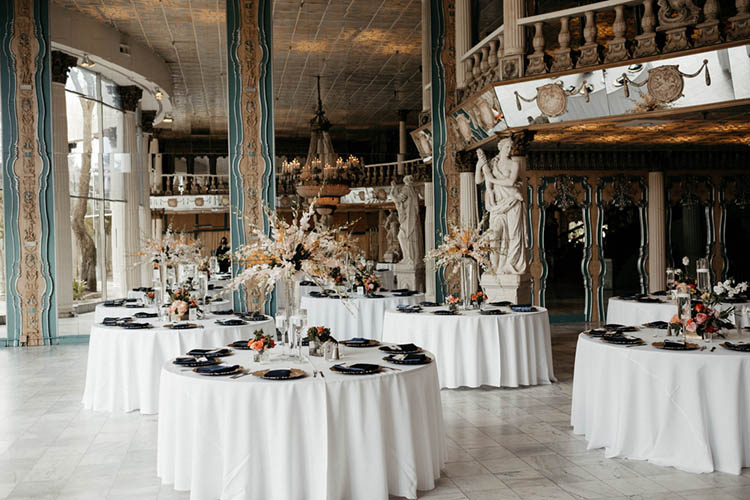 Greek & Italian Inspired Wedding Reception Venue with Columns & Marble Statues | photo by The Portos