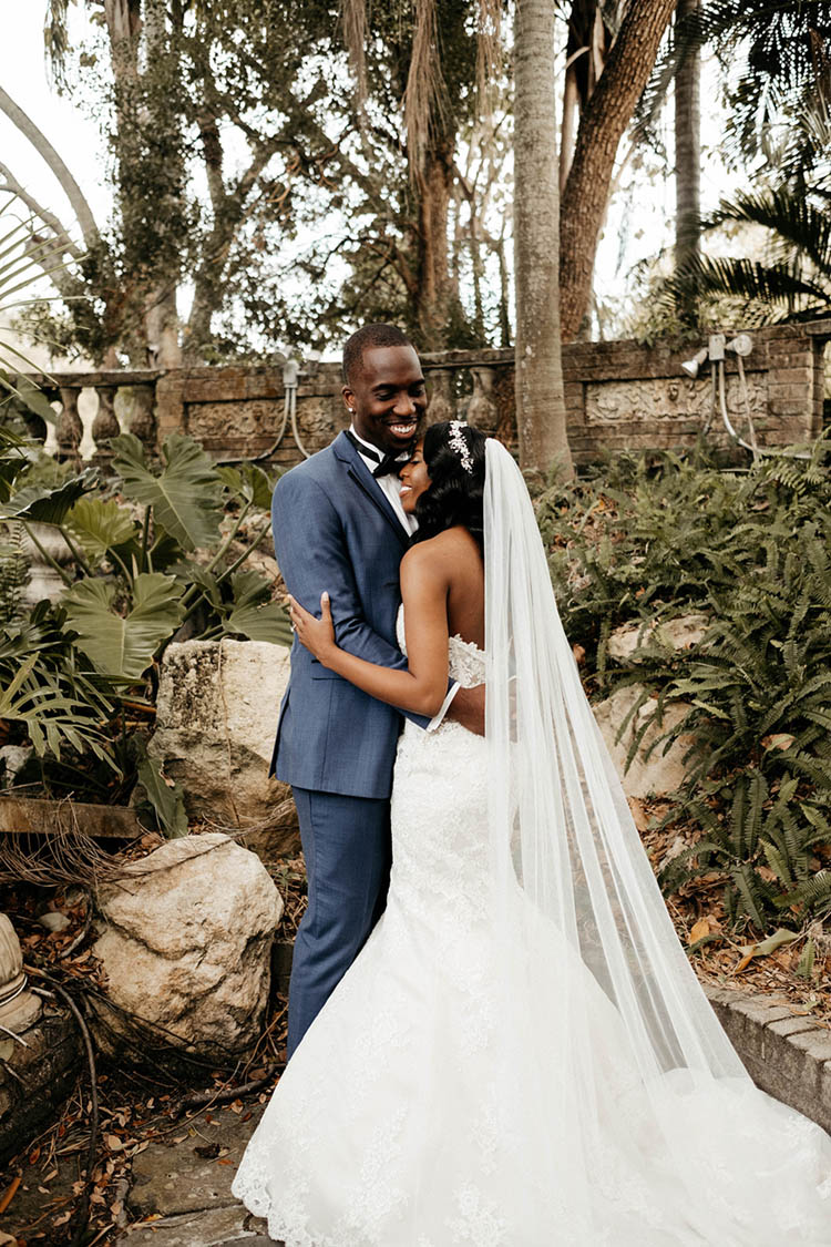 Bride & Groom Hugging During First Look at Glamorous Wedding | photo by The Portos