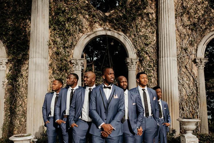 Groom & Groomsmen in Blue Suits with Black Ties & Bowties | photo by The Portos