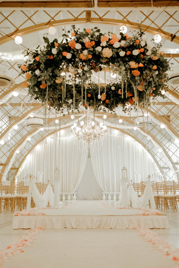 Glamorous & Chic White & Gold Wedding Ceremony with Hanging Floral Centerpiece | photo by The Portos