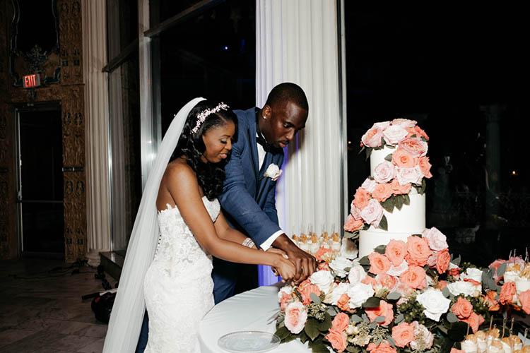 Cake Cutting at Glamorous Wedding | photo by The Portos