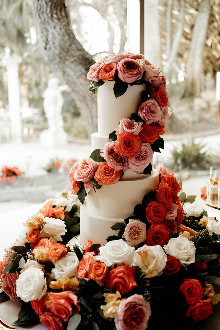 4-Tiered Wedding Cake Covered in Pink & Peach Roses | photo by The Portos