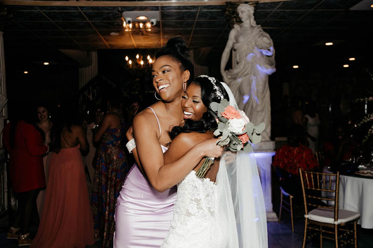 Bride Hugging Guest Who Caught Bouquet at Glamorous Wedding | photo by The Portos