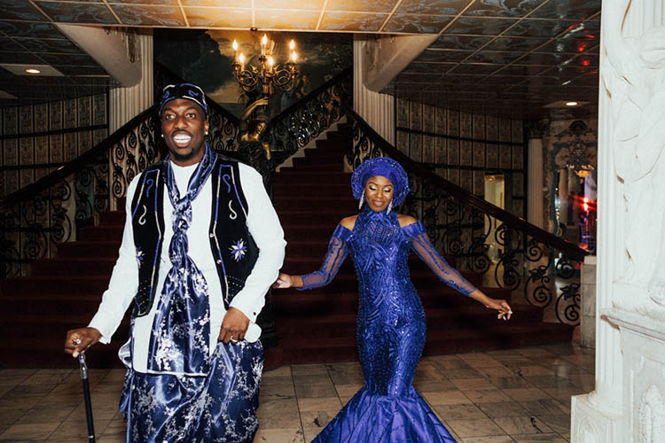 Couple in Nigerian Wedding Attire Re-Entering Wedding  photo by The Portos
