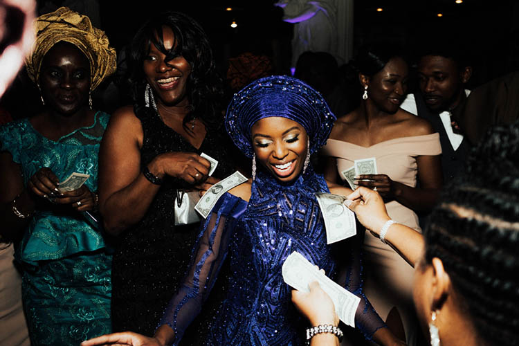 Nigerian Bride During Spraying of Money Tradition | photo by The Portos