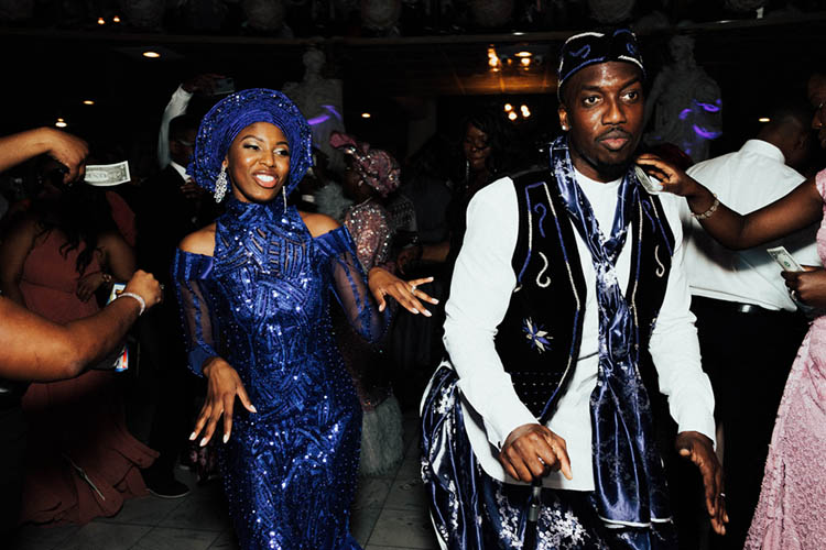 Couple in Nigerian Wedding Attire for Spraying of Money Tradition | photo by The Portos