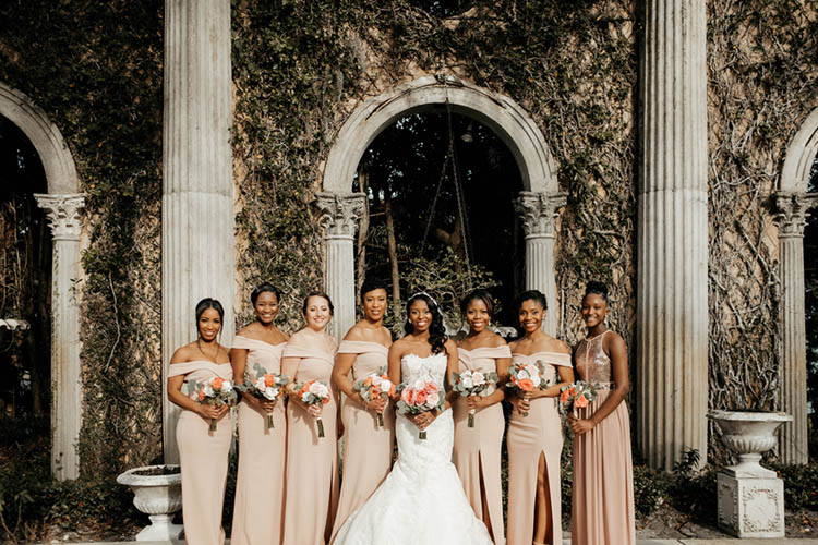 Bridesmaids in Neutral Off the Shoulders Gowns | photo by The Portos